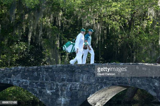 Sergio Garcia of Spain and caddie Glen Murray cross the Nelson Bridge on the 13th hole during the final round of the 2017 Masters Tournament at...