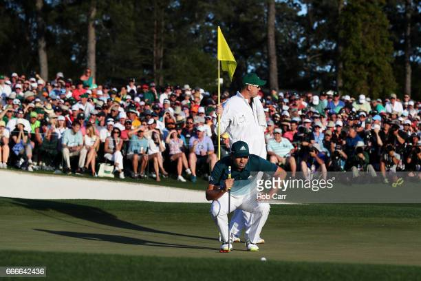 Sergio Garcia of Spain and caddie Glen Murray line up a putt on the 18th green during the final round of the 2017 Masters Tournament at Augusta...
