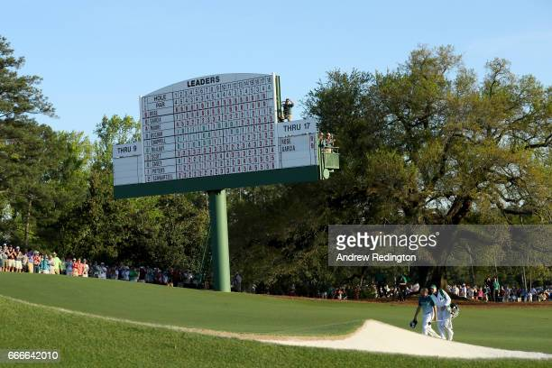 Sergio Garcia of Spain and caddie Glen Murray walk to the 18th green during the final round of the 2017 Masters Tournament at Augusta National Golf...