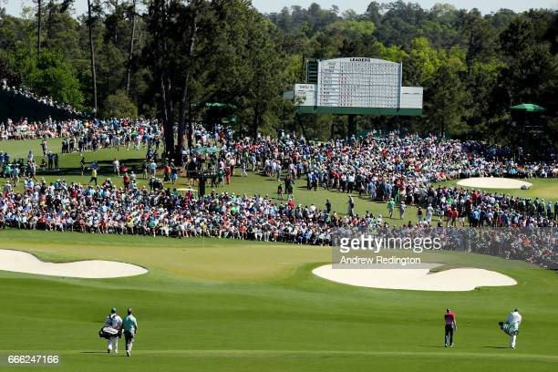 Sergio Garcia of Spain and Charley Hoffman of the United States walk to the second green during the third round of the 2017 Masters Tournament at...