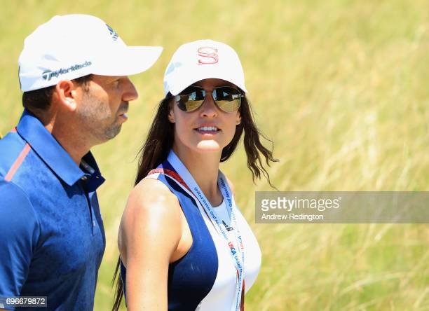 Sergio Garcia of Spain and fiancée Angela Akins walk off the course during the second round of the 2017 US Open at Erin Hills on June 16 2017 in...