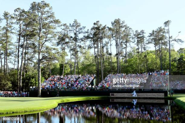 Sergio Garcia of Spain and Glen Murray cross the Sarazen Bridge on the 15th hole during the final round of the 2017 Masters Tournament at Augusta...