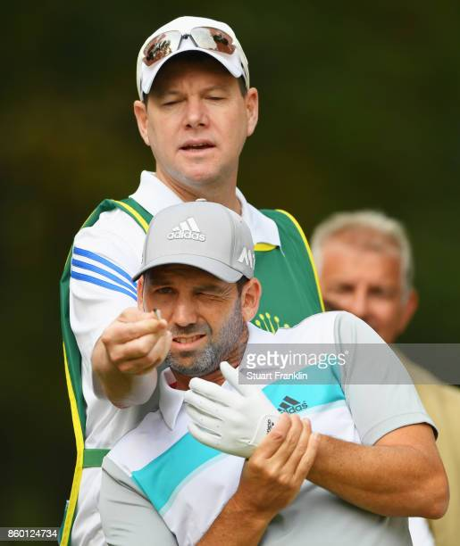 Sergio Garcia of Spain and his caddie Glenn Murray line up a shot during the Pro Am tournament ahead of the Italian Open at Golf Club Milano Parco...