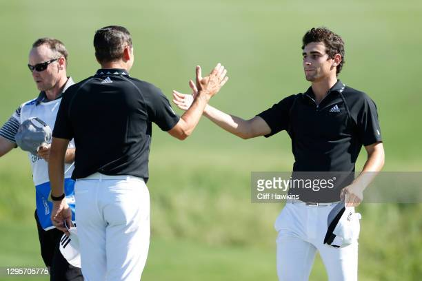 Sergio Garcia of Spain and Joaquin Niemann of Chile react after finishing on the 18th green during the final round of the Sentry Tournament Of...