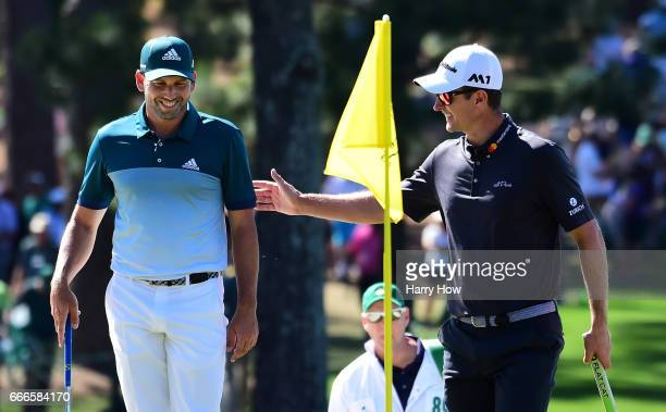 Sergio Garcia of Spain and Justin Rose of England laugh on the seventh green during the final round of the 2017 Masters Tournament at Augusta...