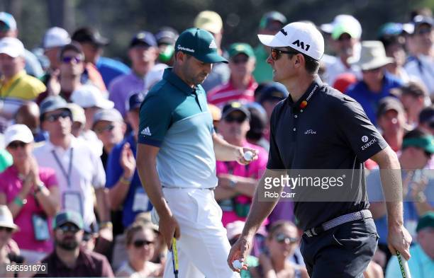 Sergio Garcia of Spain and Justin Rose of England walk across the ninth green during the final round of the 2017 Masters Tournament at Augusta...