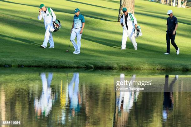 Sergio Garcia of Spain and Justin Rose of England walk on the 16th hole during the final round of the 2017 Masters Tournament at Augusta National...