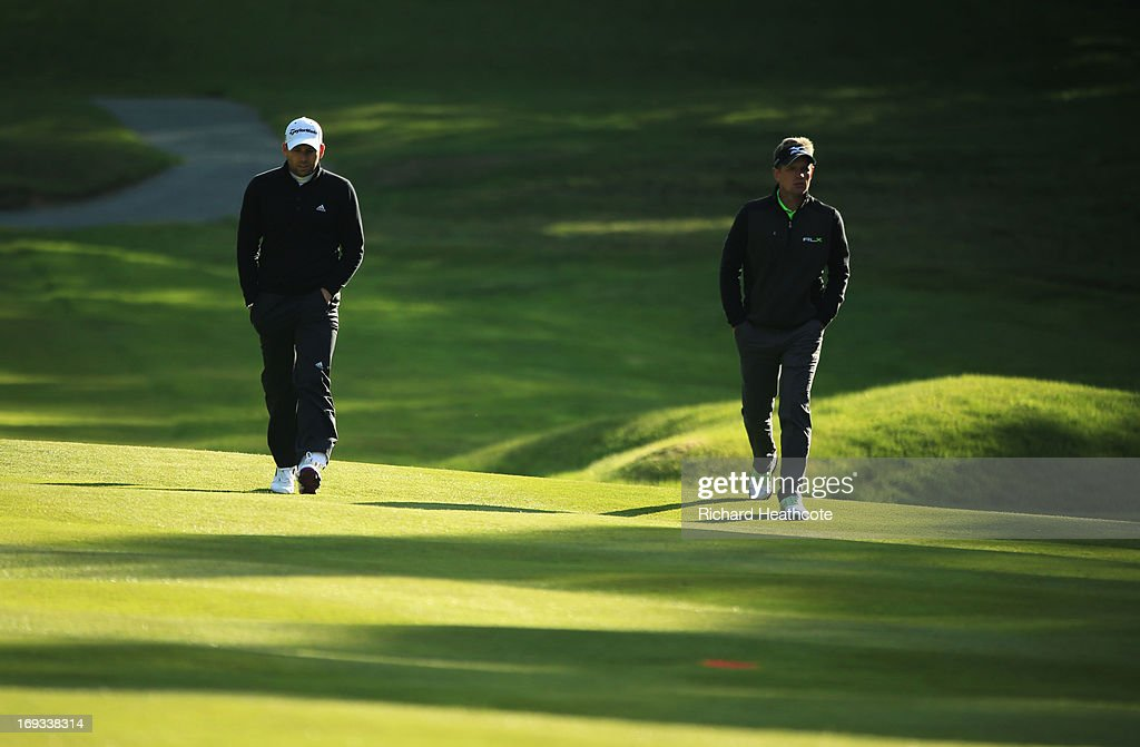 Sergio Garcia of Spain and Luke Donald of England walk down the fairway during the first round of the BMW PGA Championship on the West Course at Wentworth on May 23, 2013 in Virginia Water, England.