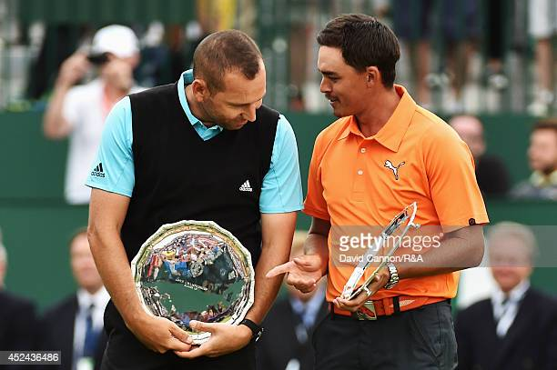 Sergio Garcia of Spain and Rickie Fowler of the United States hold their trophies for finishing in second place after the final round of The 143rd...