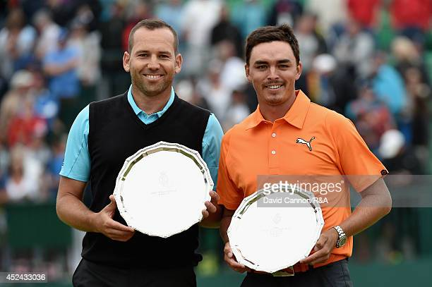 Sergio Garcia of Spain and Rickie Fowler of the United States celebrate with their secondplace trophies during the trophy presentation after the...
