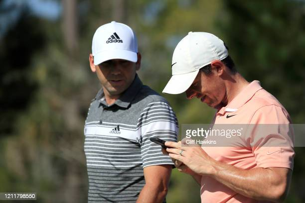 Sergio Garcia of Spain and Rory McIlory of Northern Ireland walk together off a tee during a practice round prior to The PLAYERS Championship on The...