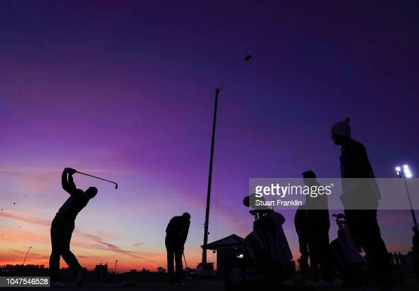 Sergio Garcia of Spain and Rory McIlroy of Northern Ireland warm up on the range prior to the morning fourball matches at Le Golf National on...