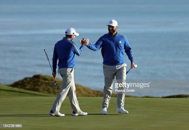 Sergio Garcia of Spain and team Europe and Jon Rahm of Spain and team Europe celebrate during Friday Morning Foursome Matches of the 43rd Ryder Cup...