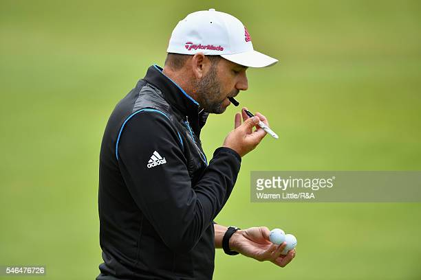 Sergio Garcia of Spain autographs some golf balls during previews ahead of the 145th Open Championship at Royal Troon on July 12 2016 in Troon...