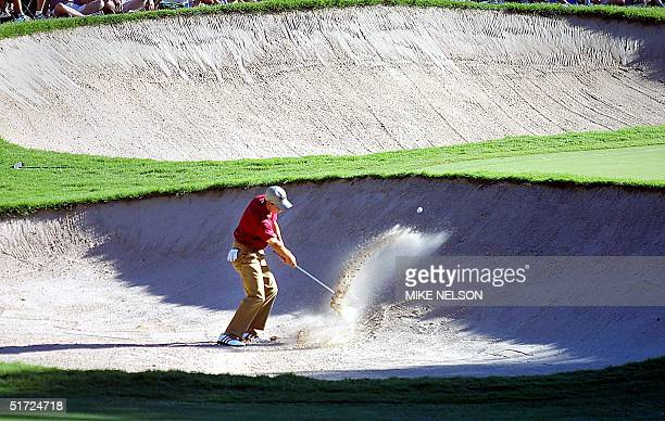 Sergio Garcia of Spain blasts out of the bunker on the 12th hole during the third round of the 2001 US Open Championship at Southern Hills Country...