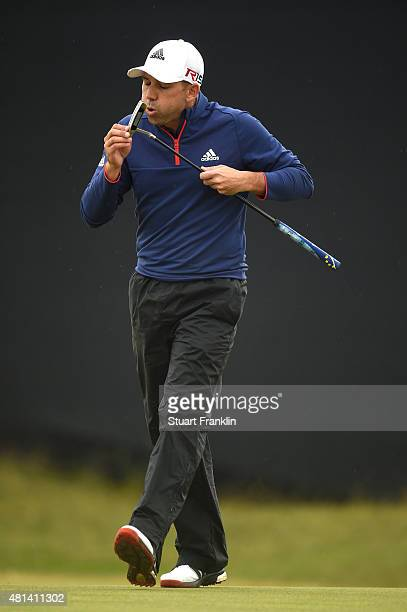Sergio Garcia of Spain blows on his putter on the 12th green during the final round of the 144th Open Championship at The Old Course on July 20 2015...