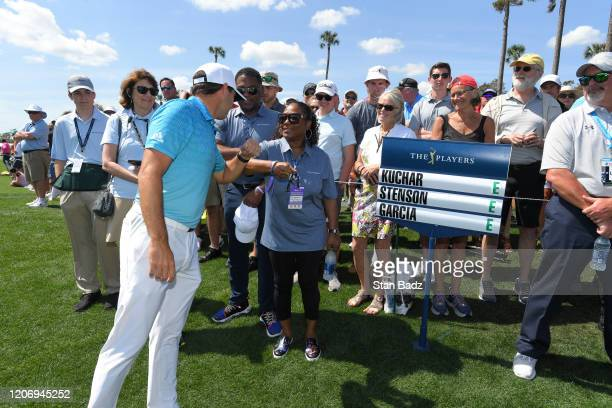 Sergio Garcia of Spain bumps elbows with Optum Honorary Observers on the first tee during the first round of THE PLAYERS Championship on THE PLAYERS...