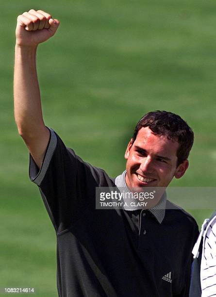 Sergio Garcia of Spain celebrates after his final putt on the 18th hole to win the 2001 Buick Classic 25 June at the Westchester Country Club in...