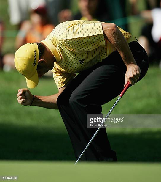 Sergio Garcia of Spain celebrates after his putt on the par three 16th hole during the final round of The Omega European Masters at the...