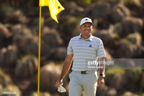 Sergio Garcia of Spain celebrates after hitting a hole in one on the fourth playoff hole in his playoff match against Lee Westwood of England during...