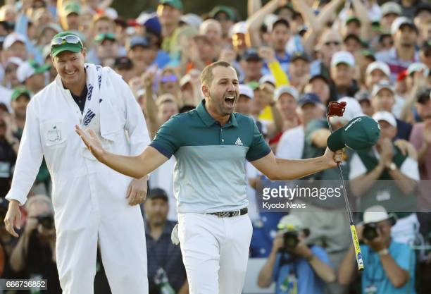 Sergio Garcia of Spain celebrates after winning his first major title with a playoff victory over Justin Rose of England at the Masters Tournament at...