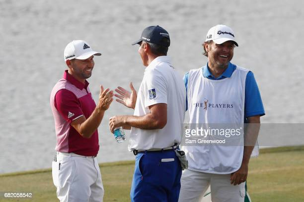 Sergio Garcia of Spain celebrates his hole in one on the 17th with Matt Kuchar of the United States during the first round of THE PLAYERS...