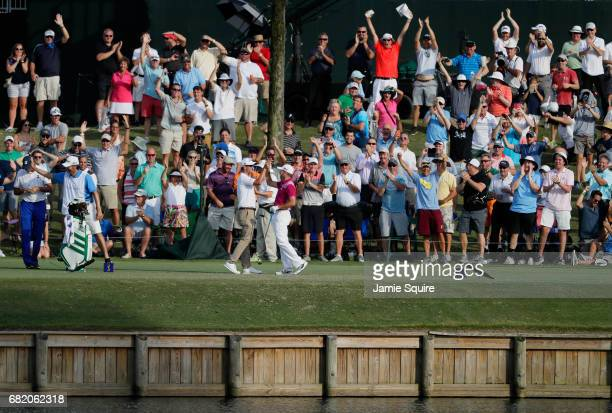Sergio Garcia of Spain celebrates his hole in one on the 17th with Adam Scott of Australia during the first round of THE PLAYERS Championship at the...