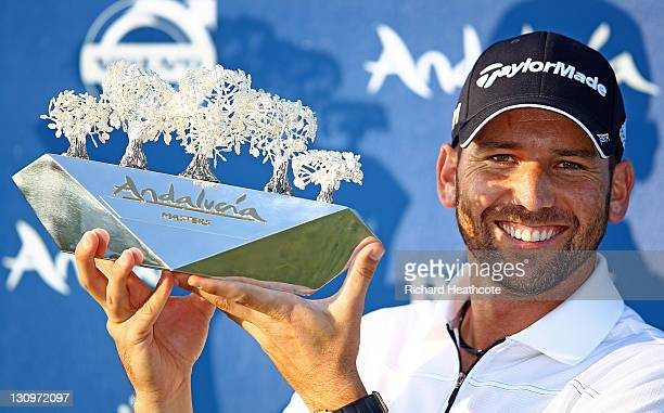 Sergio Garcia of Spain celebrates victory with the trophy after the final round of the Andalucia Masters at Valderrama on October 30 2011 in...