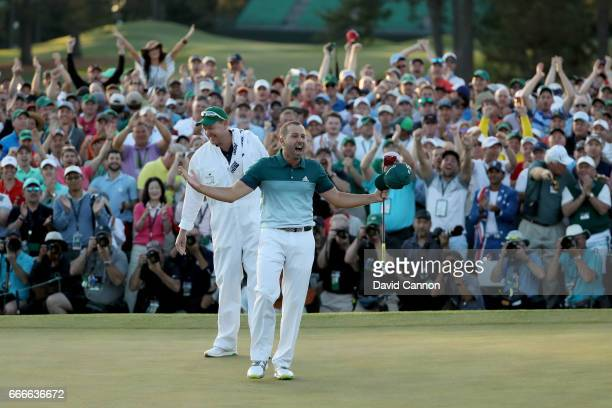 Sergio Garcia of Spain celebrates with caddie Glen Murray after defeating Justin Rose of England on the first playoff hole during the final round of...