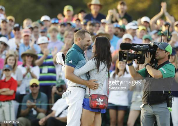 Sergio Garcia of Spain celebrates with his fiance after winning the Masters Tournament at Augusta National Golf Club on April 9 beating Justin Rose...