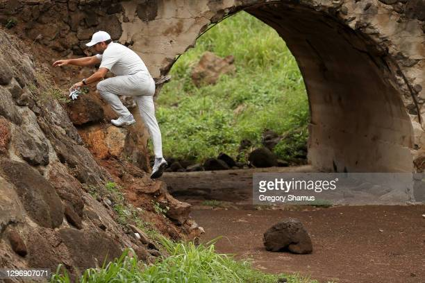 Sergio Garcia of Spain climbs out of the hazard on the eighth hole during the final round of the Sony Open in Hawaii at the Waialae Country Club on...