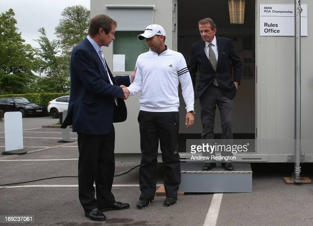 Sergio Garcia of Spain emerges from a meeting in the rules office with George O'Grady, Chief Executive of the European Tour and Tim Finchem, PGA Tour...