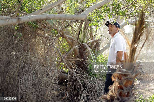 Sergio Garcia of Spain finds his tee shot on the 17th hole has rebounded unluckily off a palm tree into an unplayable lie in a bush during the third...