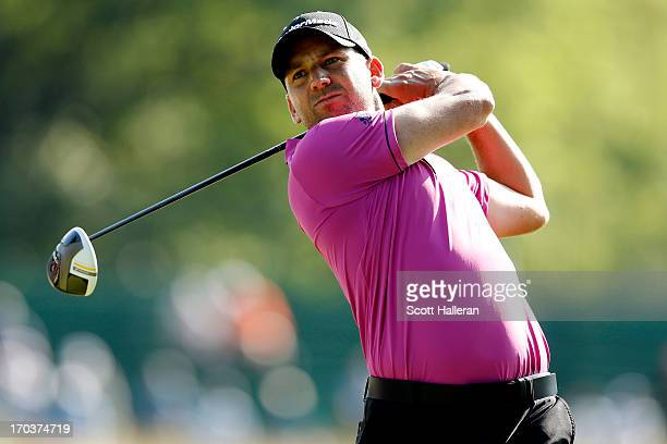 Sergio Garcia of Spain hits a tee shot during a practice round prior to the start of the 113th U.S. Open at Merion Golf Club on June 12, 2013 in...
