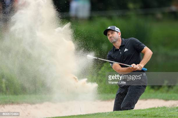 Sergio Garcia of Spain hits from a bunker on the 11th hole during day three of the BMW International Open at Golfclub Munchen Eichenried on June 24...