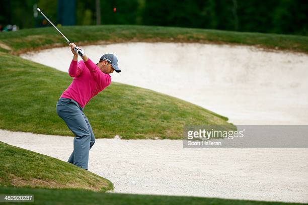 Sergio Garcia of Spain hits his ball out of the bunker on the eighth hole during round three of the Shell Houston Open at the Golf Club of Houston on...