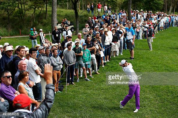 Sergio Garcia of Spain hits his second shot on the 1st hole watched by his fans during the final round of the Open de Espana held at PGA Catalunya...