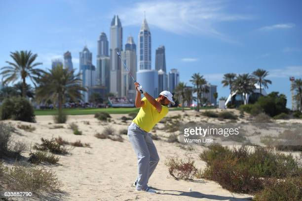Sergio Garcia of Spain hits his second shot on the 8th hole during the final round of the Omega Dubai Desert Classic at Emirates Golf Club on...