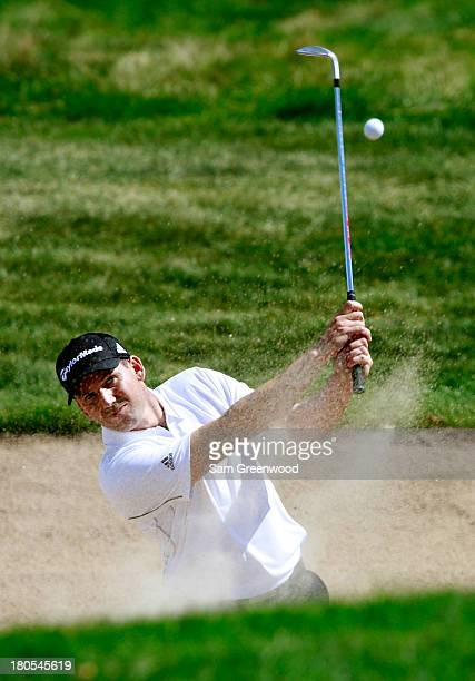Sergio Garcia of Spain hits out of a bunker on the seventh hole during the Third Round of the BMW Championship at Conway Farms Golf Club on September...