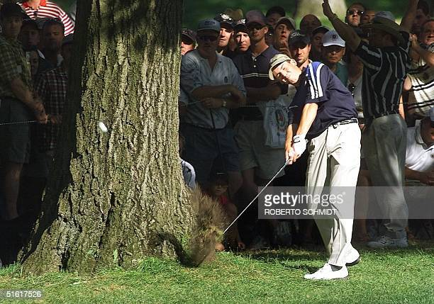 Sergio Garcia of Spain hits past a tree on the 16th fairway 15 August, 1999 during the final round of the 81st PGA Championship held on the No. 3...