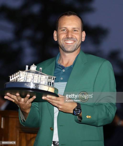 Sergio Garcia of Spain holds the winning trophy after winning the Masters Tournament at Augusta National Golf Club on April 9 beating Justin Rose of...