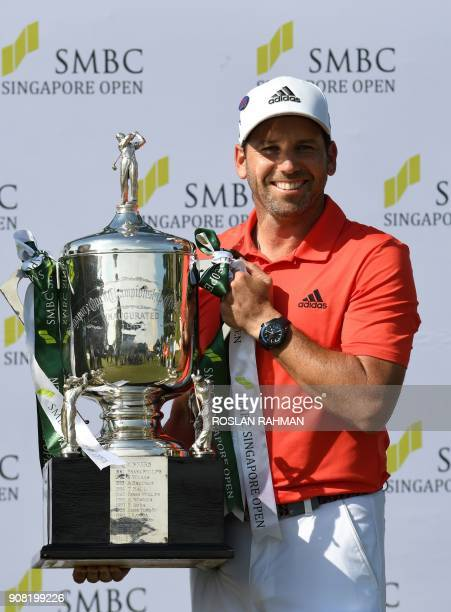 Sergio Garcia of Spain holds up the winner's trophy after his victory in the Singapore Open golf tournament at the Serapong golf course in Singapore...