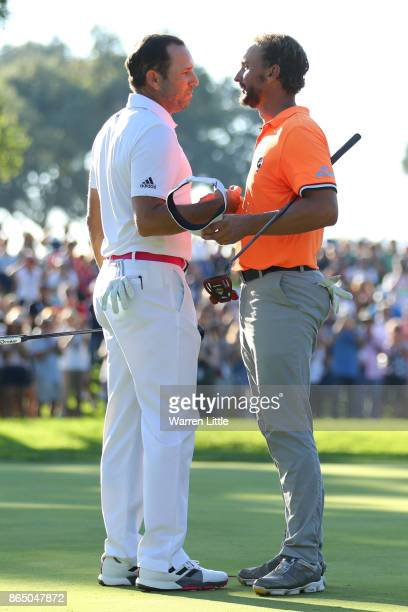 Sergio Garcia of Spain is congratulated on his victory on the 18th green by Joost Luiten of the Netherlands during the final round of of the...