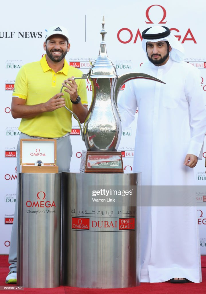 Sergio Garcia of Spain is presented with the trophy by His Highness Shaikh Ahmed Bin Mohammed Bin Rashid Al Maktoum the President of the UAE National Olympic Committee after winning the Omega Dubai Desert Classic on the Majlis course at Emirates Golf Club on February 5, 2017 in Dubai, United Arab Emirates.