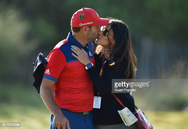 Sergio Garcia of Spain kisses his fiancee Angela Akins during a practice round prior to the 146th Open Championship at Royal Birkdale on July 18 2017...