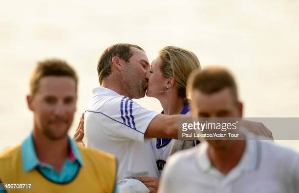 Sergio Garcia of Spain kisses his girlfriend and caddy Katharina Boehm of Germany on the 18th green after his win during day four of the Thailand...