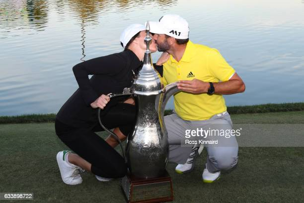 Sergio Garcia of Spain kisses his girlfriend Angela Akins following his victory during the final round of the Omega Dubai Desert Classic at Emirates...