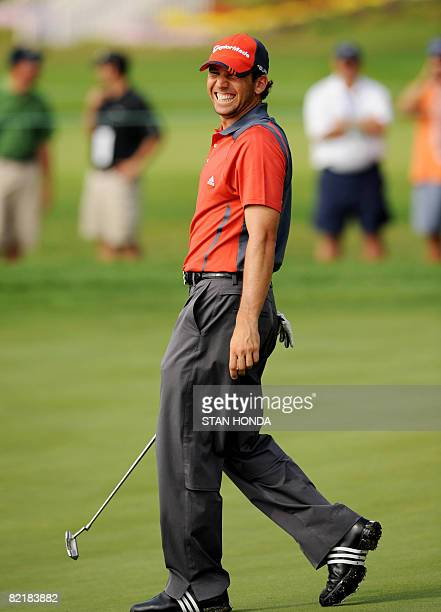 Sergio Garcia of Spain laughs on the 13th green as he talks to fellow player Mike Weir of Canada during a practice round for the 90th PGA...