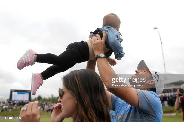 Sergio Garcia of Spain lifts his daughter, Azalea Adele Garcia in the air as he celebrates victory on the eighteenth green during Day Four of the KLM...