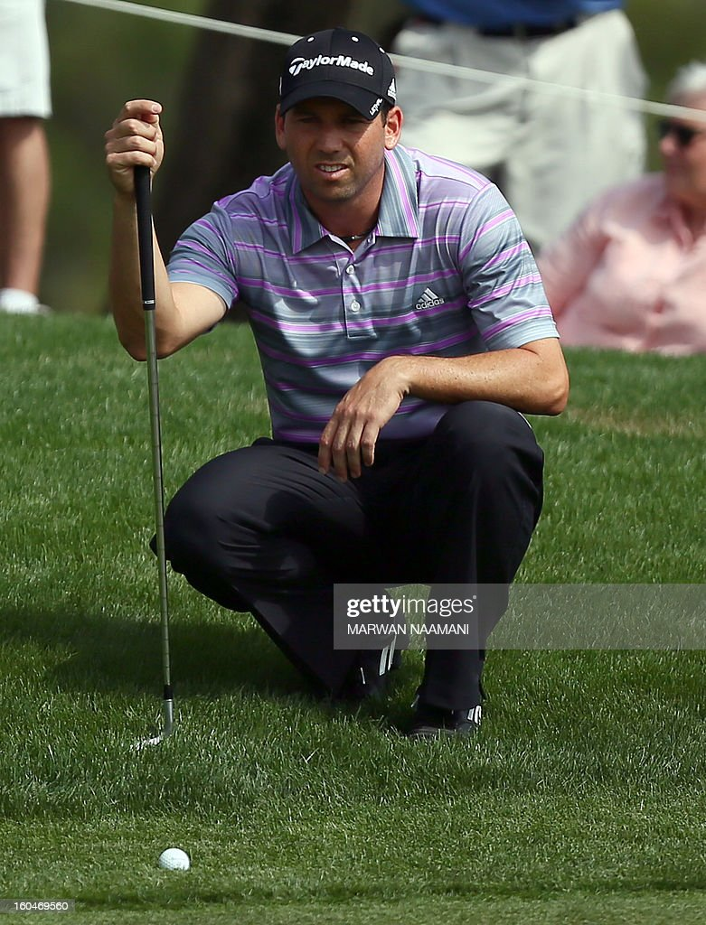 Sergio Garcia of Spain lines a putt during the second round of the Dubai Desert Classic golf tournament in the Gulf emirate of Dubai on February 1, 2013.